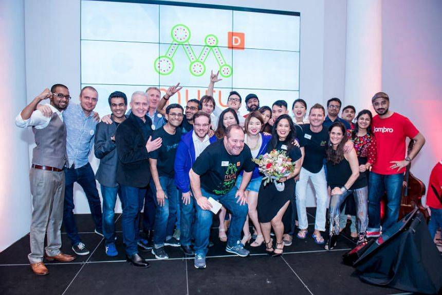 Paul Meyers, head of muru-D Singapore, with the 10 graduating start-ups at Demo Day.