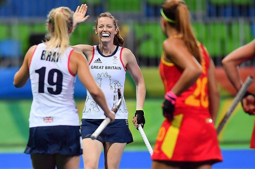 Britain's Helen Richardson-Walsh (centre) celebrates a goal during their women's quarter-final field hockey match against Spain at the Rio 2016 Olympics Games.