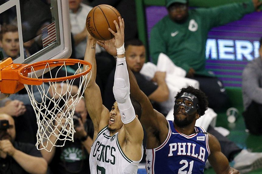 Philadelphia centre Joel Embiid failing to stop Boston forward Jayson Tatum from attacking the basket at the TD Garden on Wednesday.