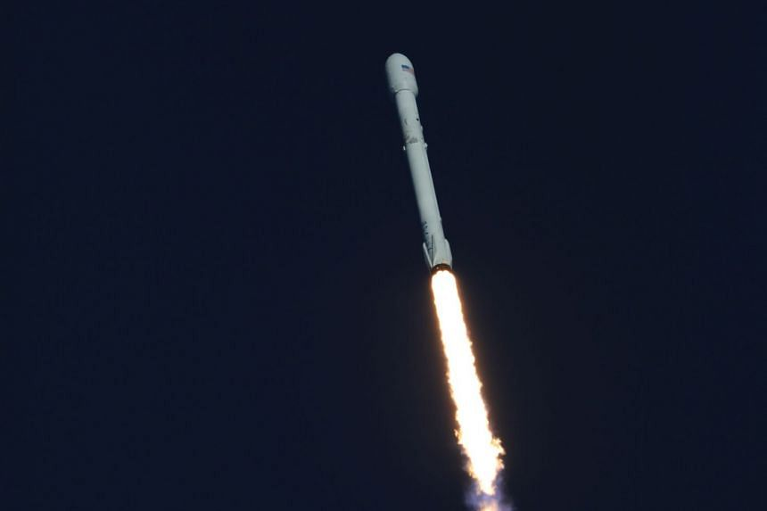 A SpaceX Falcon 9 rocket lifting off in April 2018, carrying a Nasa satellite.