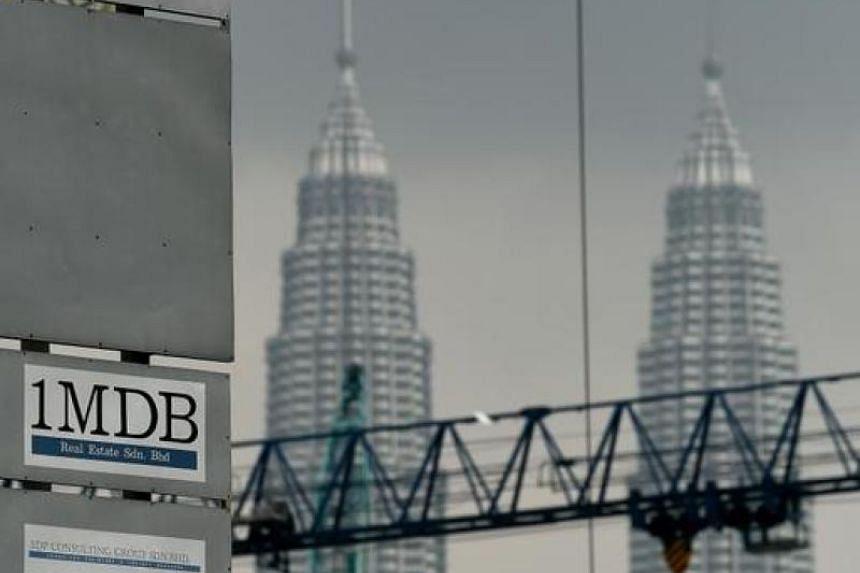 The 1 Malaysia Development Berhad (1MDB) logo is seen on a billboard at the funds flagship Tun Razak Exchange under-development site in Kuala Lumpur on July 3, 2015.