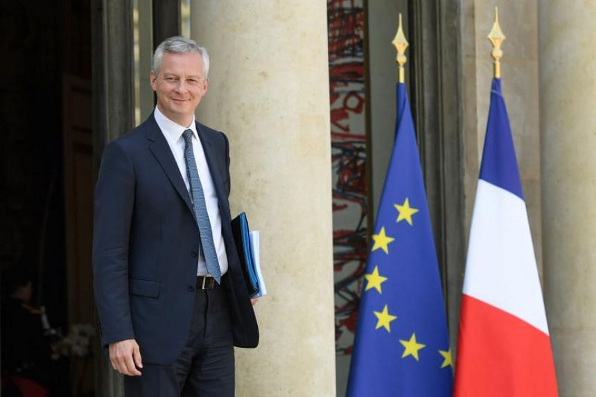 French Economy Minister Bruno Le Maire leaves the Elysee Presidential palace in Paris after the weekly cabinet meeting on May 9, 2018.