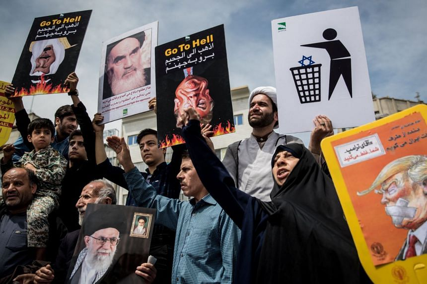 Iranians shout slogans during a protest against President Donald Trump's decision to walk out of the 2015 nuclear deal, in Teheran, May 11, 2018.