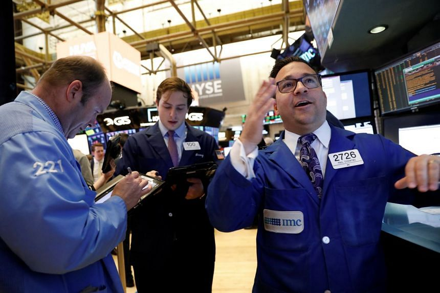 Traders work on the floor of the New York Stock Exchange, May 11, 2018.