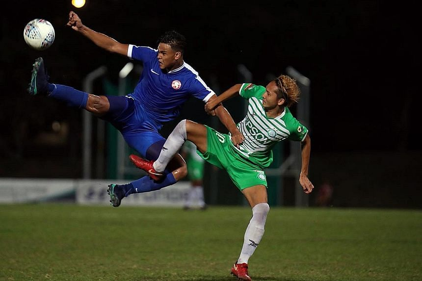 Bottom club Geylang International's Fumiya Kogure (in green) tussling with Young Lions' Irfan Fandi on Wednesday. The teams drew 1-1.