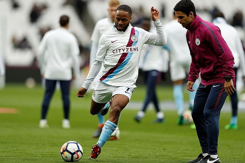 Manchester City are eager to offer Raheem Sterling (right, with co-assistant coach Mikel Arteta) a new long-term contract after his most successful season, in which he has scored 23 goals in all competitions.