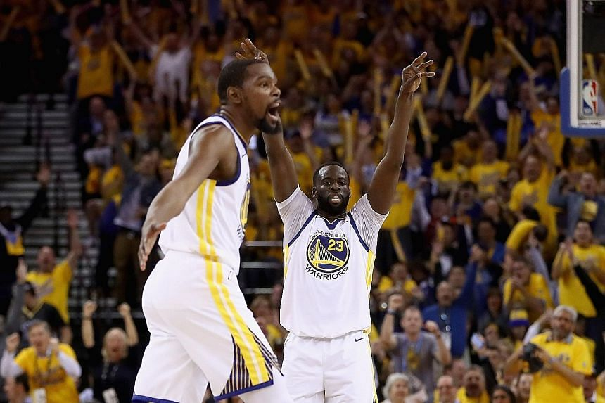 Kevin Durant (left) of the Golden State Warriors and Draymond Green reacting after Stephen Curry (not pictured) made a shot against the New Orleans Pelicans during Game 5 of the Western Conference semi-finals. The Warriors will face the Houston Rocke