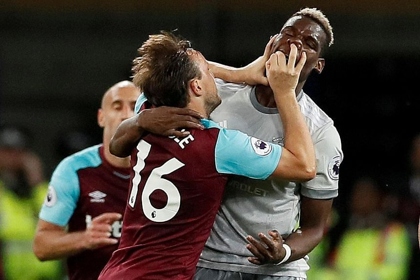 West Ham United's Mark Noble (far left) and Manchester United's Paul Pogba attempting a late version of boxing's Golden Gloves in the EPL match at the London Stadium on Thursday.