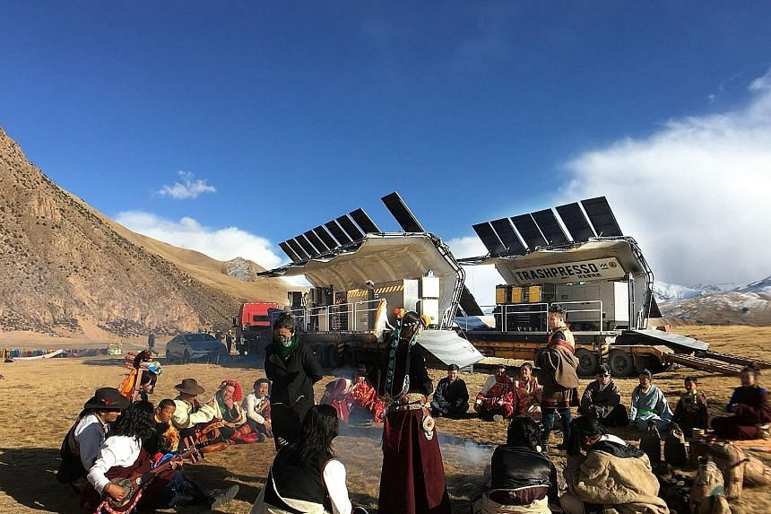 The mobile, solar-powered Trashpresso (above, in Qinghai) converts trash into solid, hexagonal tiles (left). The machine was the result of a collaboration between Hong Kong action star Jackie Chan and Miniwiz founder Arthur Huang.