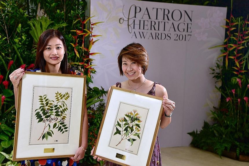 Patrons, such as Ms Mavis Toh (far left) of Lee Hwa Jewellery and Ms Esther Loo of Tai Sun (Lim Kee) Food Industries, were given reproductions of watercolour drawings from the National Museum's William Farquhar Collection of Natural History Drawings.