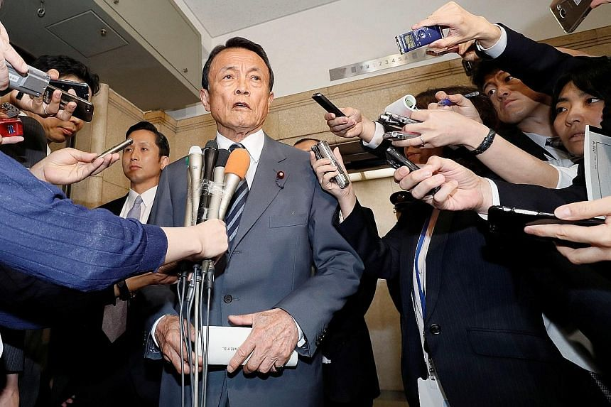 Mr Taro Aso's remarks last week sparked small-scale protests in cities from Sapporo to Kyoto.