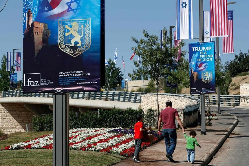 Posters praising President Donald Trump hanging along the streets near the new US embassy in Jerusalem. When embassy staff move in, 450 retirees, including Madam Bela Winokul (above), will lose their home.