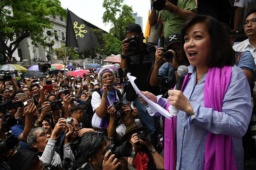 """Ousted Philippine chief justice Maria Lourdes Sereno addressing her supporters in front of the Supreme Court building in Manila yesterday. One opposition party said the ouster of Ms Sereno, the country's first female chief justice, left behind a """"pup"""