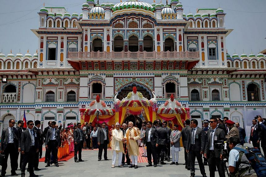 Indian Prime Minister Narendra Modi and his Nepalese counterpart K.P. Sharma Oli outside the Janaki Temple in Janakpur yesterday. Mr Modi will visit a second Hindu pilgrimage site near Nepal's border with Tibet today.