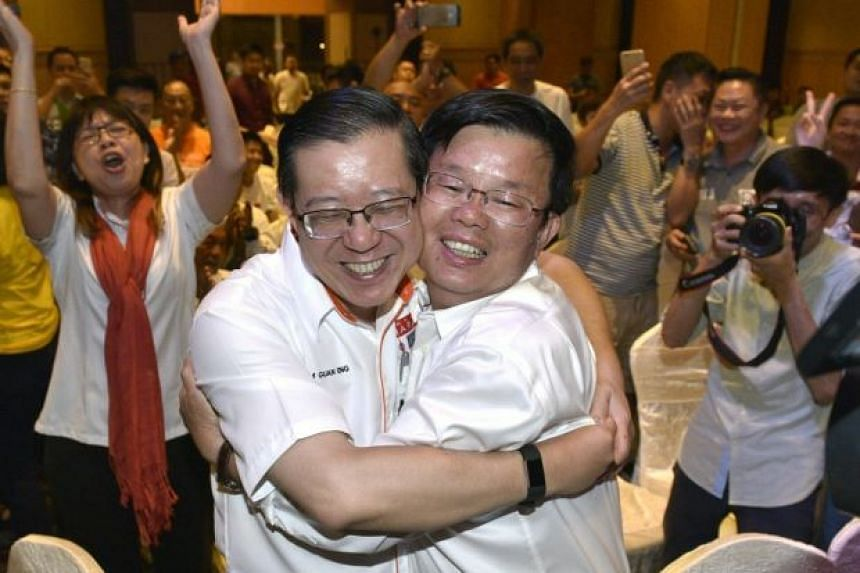 Penang Democratic Action Party chairman Chow Kon Yeow (right) celebrates with Penang Chief Minister Lim Guan Eng after results of Malaysia's 14th general election were announced on May 9, 2018.