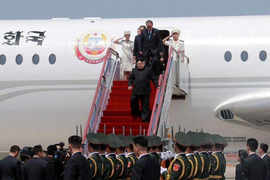 North Korean leader Kim Jong Un (centre) arriving in the Chinese city of Dalian, on May 7, 2018.