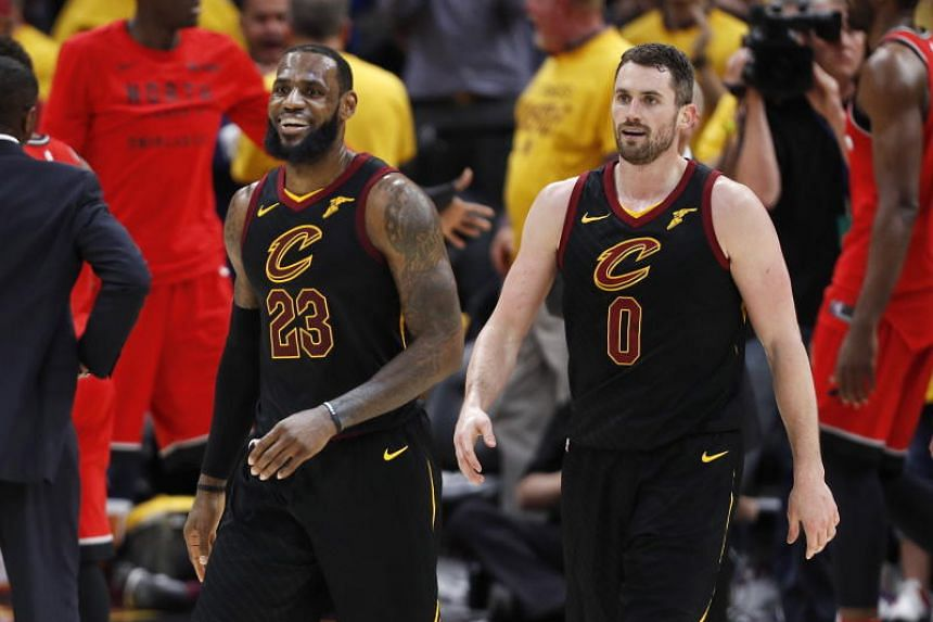 The Cleveland Cavaliers' LeBron James (left) and Kevin Love (right) walk to the bench during a timeout during the National Basketball Association game against the Toronto Raptors at Quicken Loans Arena in Cleveland on May 7, 2018.
