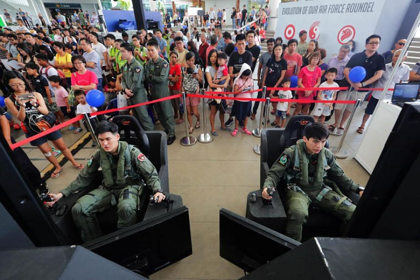 Republic of Singapore Air Force (RSAF) pilots taking part in an air combat simulation during an event by the RSAF in celebration of its golden jubilee.