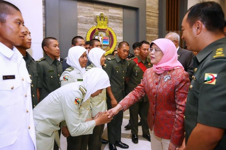 President Halimah Yacob being shown around the Royal Brunei Armed Forces Defence Academy on May 12, 2018.