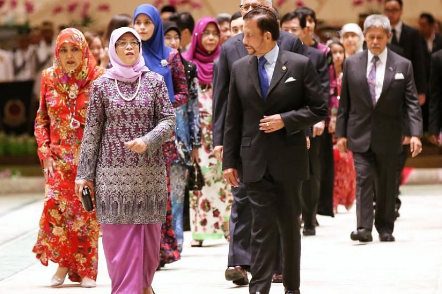 President Halimah Yacob and Brunei Sultan Hassanal Bolkiah attending the State Banquet at Istana Nurul Iman on May 12, 2018.