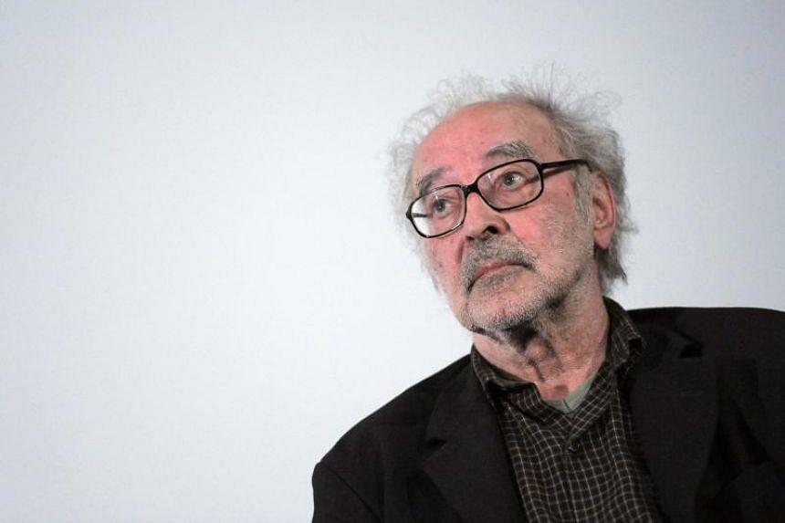 Swiss film director Jean-Luc Godard attends a debate when presenting his last movie 'Film socialiste' (Socialist movie) at the Cinema des cineastes in Paris on June 19, 2010.