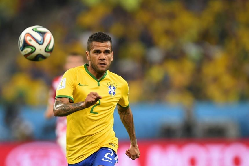 Alves in action for Brazil during the last World Cup.
