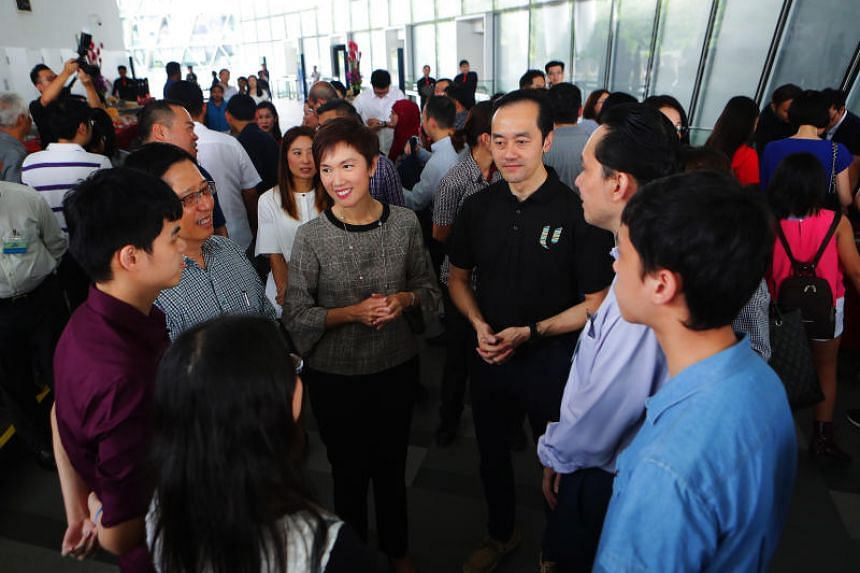 Manpower Minister Josephine Teo (third from left) and NTUC Deputy Secretary-General Koh Poh Koon (fourth from left) at a luncheon to honour over 130 jobseekers who successfully found new jobs through the Adapt and Grow initiative.