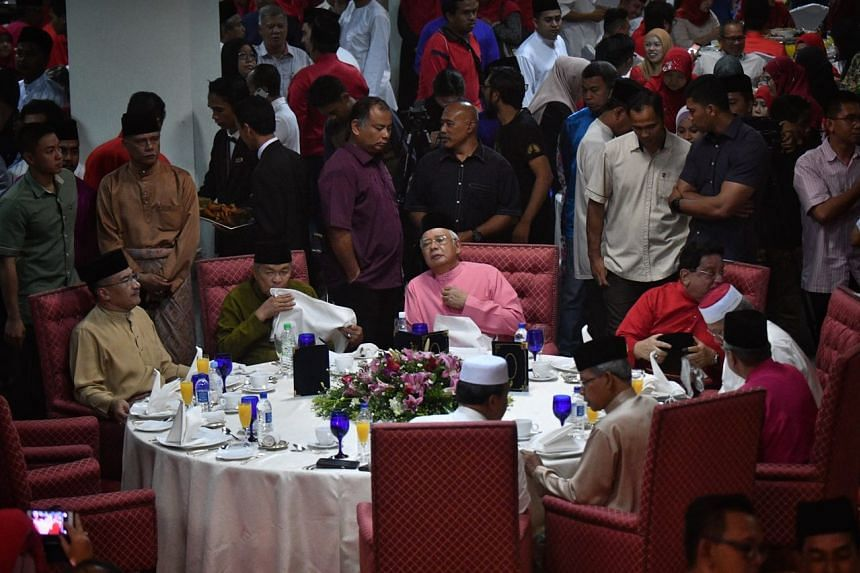 BN leaders having dinner after their prayers at a hall in UMNO headquarters during the party's 72nd anniversary on 11 May 2018.