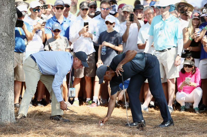 Woods gets a ruling from an offcial on the 16th hole during the second round.