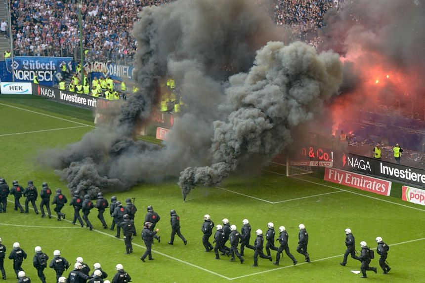 Riot police lined up across the pitch at the end of the match.