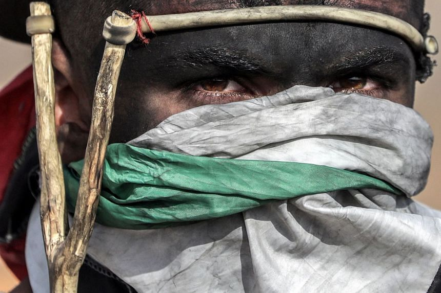 A Palestinian protester taking part in clashes near the border with Israel in the east of Gaza City.