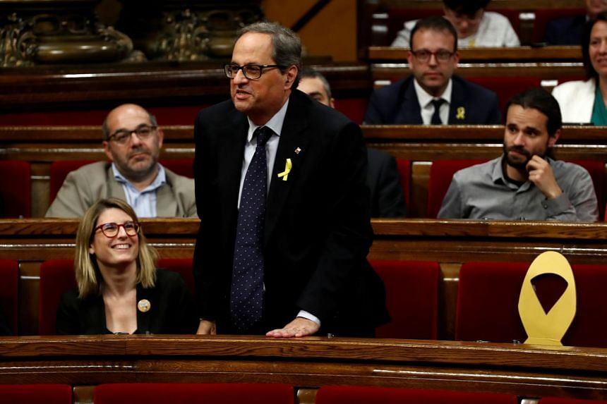 Quim Torra votes during his investiture debate at the regional parliament in Barcelona, Spain, May 12, 2018.