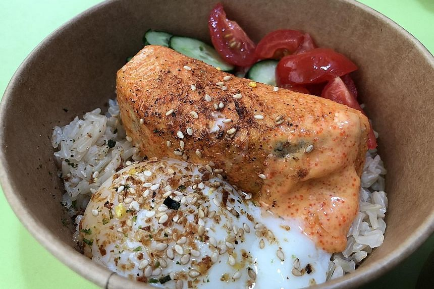 The fish in the mentaiko salmon bowl is generously slathered with roe.