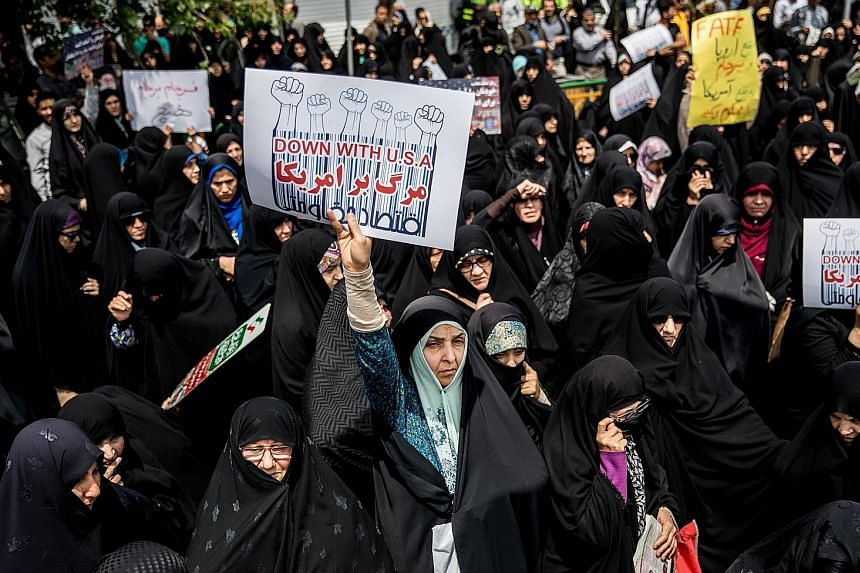 Iranian women protesting against US President Donald Trump's decision to withdraw from the 2015 nuclear agreement, during a demonstration in Teheran on Friday.