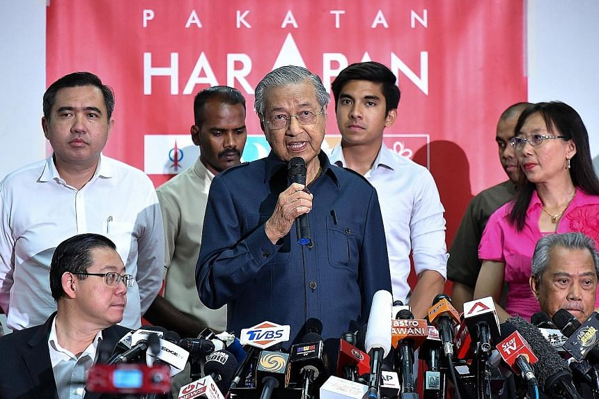 Mr Mohamad Sabu, president of Parti Amanah Negara, was named Malaysia's Defence Minister yesterday. Prime Minister Mahathir Mohamad at a news conference in Petaling Jaya yesterday with Pakatan Harapan elected officials and leaders, including (seated,