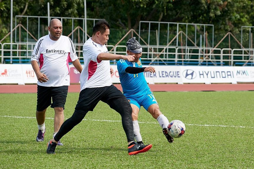 Hougang CSC took on Dads for Life at Hougang yesterday in a friendly match. It was part of a wide range of grassroot activities by the Football Association of Singapore this weekend.