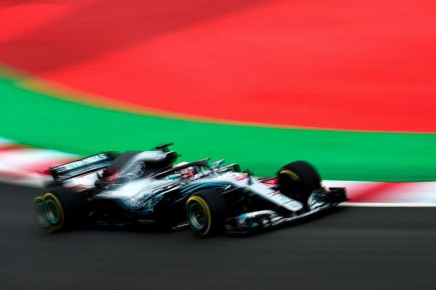 Mercedes' Lewis Hamilton in action during the third practice session at the Circuit de Catalunya in the outskirts of Barcelona yesterday. He has a four-point lead over Ferrari's Sebastian Vettel in the drivers' standings going into today's race.