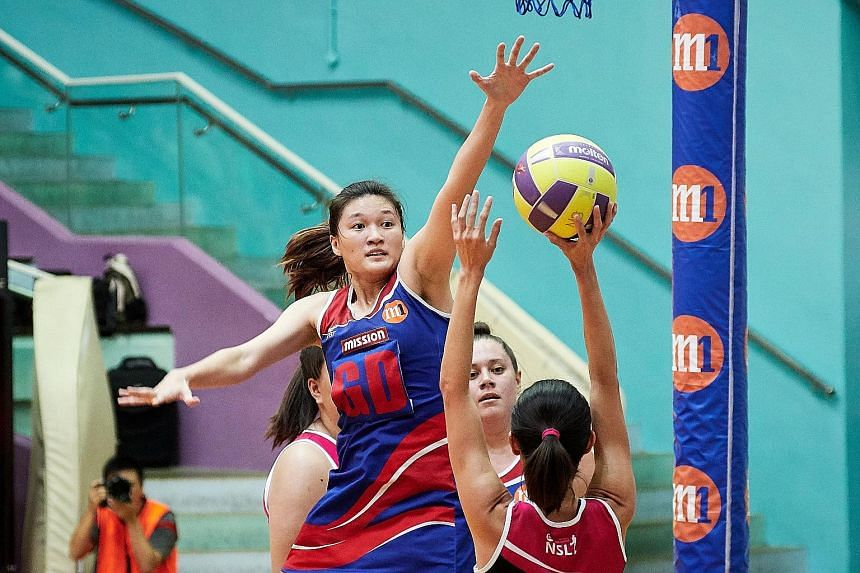 Mission Mannas' goal defence Shina Teo attempting a block during the M1 Netball Super League final against the Blaze Dolphins at the Toa Payoh Sports Hall yesterday. The Mannas, who are the defending champions, lost 41-46.