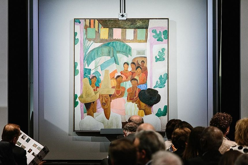 "Up for auction were treasures that included furniture and porcelain (above) and paintings such as Diego Rivera's ""Los Rivales"" (left). Although the sale did not cross the US$1 billion threshold as speculated, it did break numerous records."
