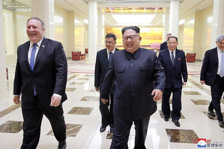 A photograph released by the official North Korean Central News Agency on Wednesday showing Secretary of State Mike Pompeo and North Korean leader Kim Jong Unin Pyongyang, North Korea, ahead of Mr Kim's summit with US President Donald Trump in Singap