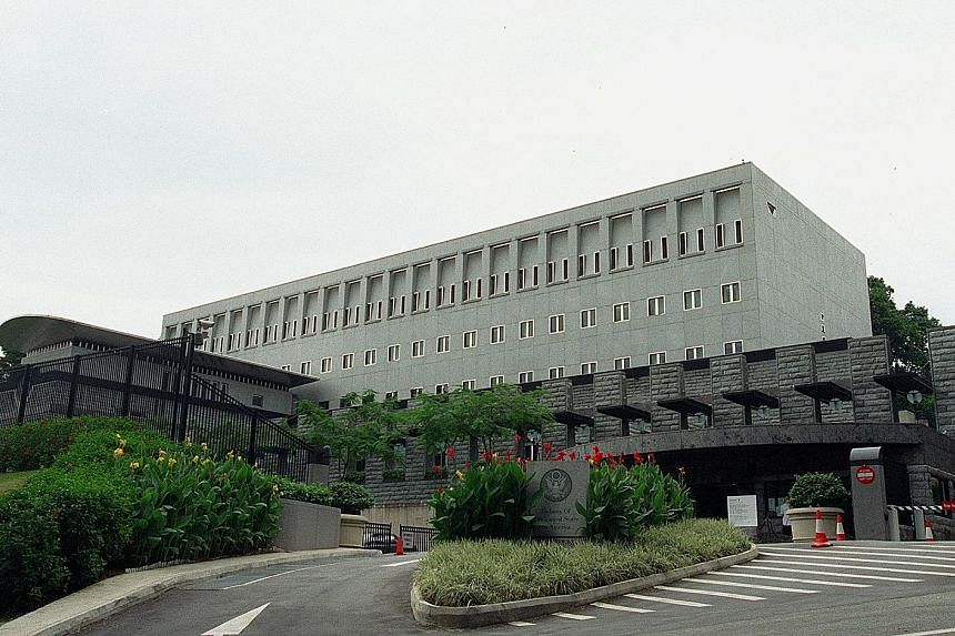 Top: The North Korean Embassy at High Street Centre, where its ambassador and three other embassy staff operate out of a suite of rooms. Above: The sprawling, high-security US Embassy in Napier Road, built at an estimated cost of US$30 million.