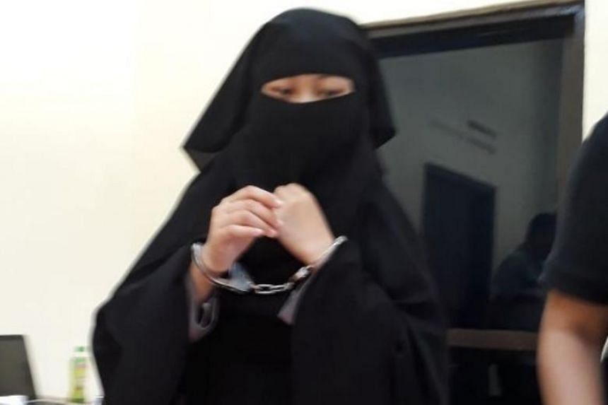 Siska Nur Azizah, 22, one of the two militant burqa-clad women who descend on the country's mobile brigade police (Brimob) headquarters to attack officers by stabbing using scisssors.