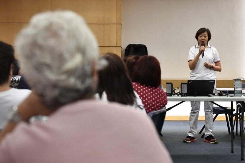 Grassroots adviser and an MP for Nee Soon GRC Lee Bee Wah speaking at the dementia go-to point training at Nee Soon South Community Club on May 13, 2018.