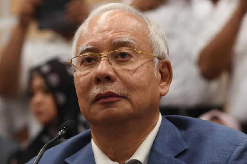 Former Malaysian prime minister Najib Razak attends a press conference to announce his resignation as president of the United Malays National Organisation, the main component party of the defeated Barisan Nasional coalition, in Kuala Lumpur on May 12