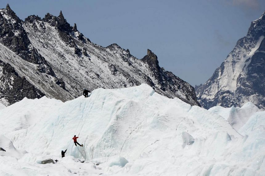 Climbers practicing their techniques on the Khumbu glacier before trying to summit Mount Everest on April 24, 2018.