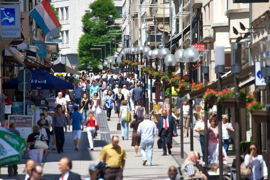 File photo showing pedestrians walking through a shopping area in Luxembourg.