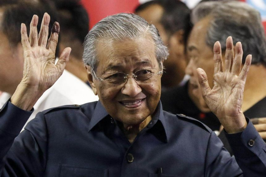 Malaysian Prime Minister Mahathir Mohamad gestures to the media at the end of a press conference in Kuala Lumpur on May 12, 2018.