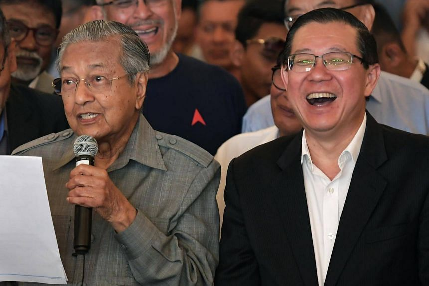 Malaysian Prime Minister Mahathir Mohamad (left) and Finance Minister Lim Guan Eng attending a press conference at the Sheraton Petaling Jaya Hotel on May 10, 2018.