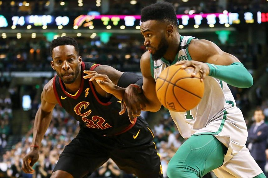 Jaylen Brown (right) of the Boston Celtics is guarded by Jeff Green  of the Cleveland Cavaliers during the second half of a game at TD Garden in Massachusetts, on Feb 11, 2018.