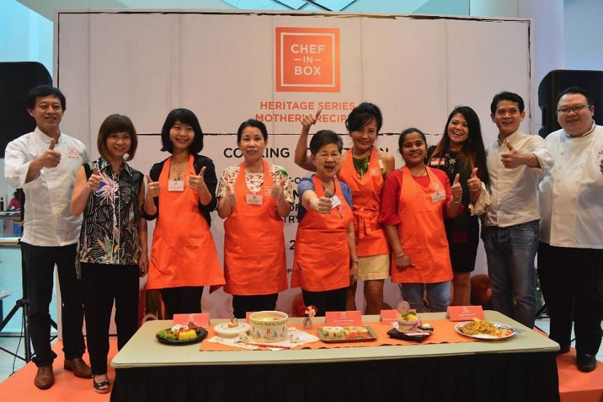 Senior Minister of State for Health and Environment and Water Resources Amy Khor (second from left) posing with contestants and other guests at the Mother's Day cook-off on May 13, 2018.